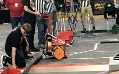 During the B.E.S.T. Robotics regionals at Wichita State University, senior Forrest Tuschhoff drives the teams robot. The team placed second which allowed them to travel to Denver, Colorado for Nationals.