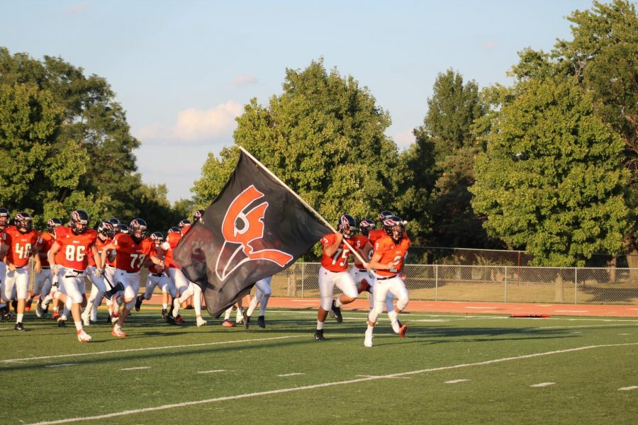 Augusta football team carried the Oriole flag ready to be back on the field Sept. 19.  The final score on was 12-20.