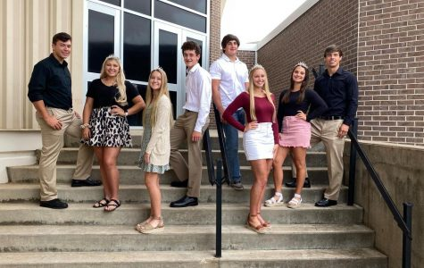 Homecoming candidates (right to left) Zack Timberlake, Morgan Pennycuff, Taylor Braungardt, Josh Manahan, Ryan Andrews, Jadyn Jackson, Payton Haskell and Duke Lichlyter stand together for a picture. King and queen will be announced Friday Oct. 2 at 6:40 p.m. before the home game against Buhler.