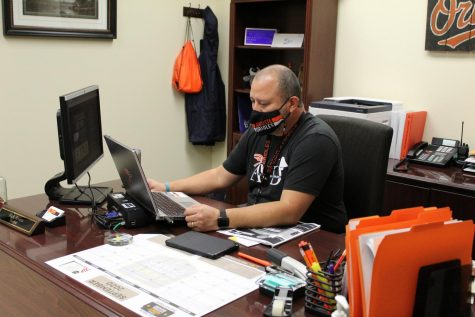Principal Rick Rivera works at his desk after school. Multiple changes had been introduced during the start of the 2020-2021 school year.