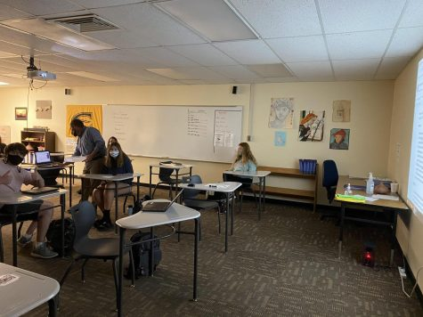 Sophomores Tanner Parscal, Alicia Matney and Elisa Stubby sit in Bradley Raines 2A World History class during a projected Zoom call. Students last names L-Z attended in-person Tuesday and Friday while A-K attended Monday and Thursday.
