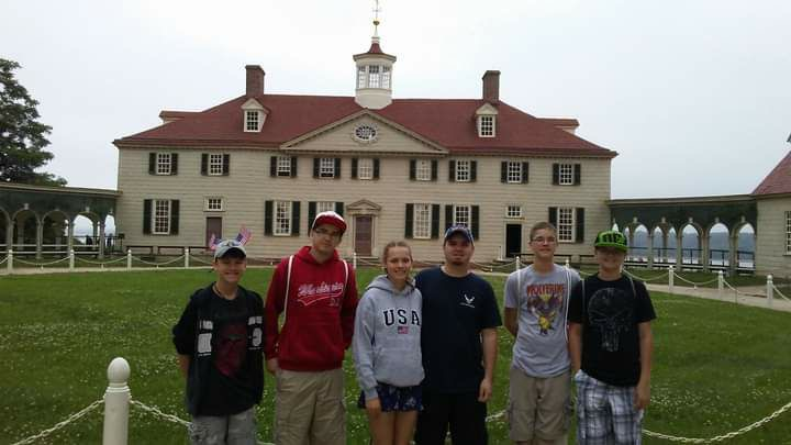 During a trip to Mt. Vernon when he was 14 years old, senior Christain Hogan and his siblings stand in front of the house George Washington lived in. The family tries to go on a vacation together every year.