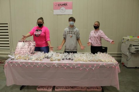 Senior Faith Lundin, sophomore Dustin Scott and senior Graycen Elliot partnered together to sell Crumbl Cookies at Market Day. They incorporated the pink in the Crumbl logo into their table decorations.