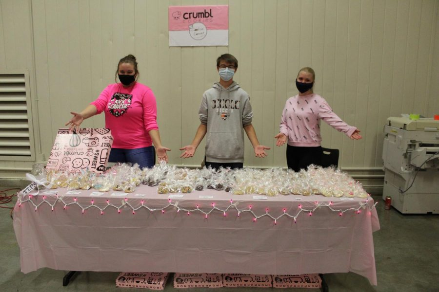 Senior+Faith+Lundin%2C+sophomore+Dustin+Scott+and+senior+Graycen+Elliot+partnered+together+to+sell+Crumbl+Cookies+at+Market+Day.+They+incorporated+the+pink+in+the+Crumbl+logo+into+their+table+decorations.