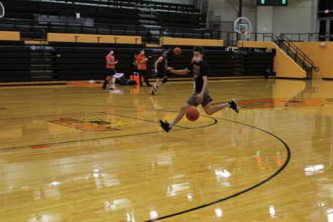 Senior Xander Roberts tries out for the basketball team Nov. 17 in the Hutter Gym. He goes in for a layup and makes it.