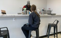 "Junior Bailey Bohon waits for her meal replacement shake to be made at ""At The Park Nutrition & Energy."" The shop's grand opening was Saturday, Nov. 7, and the owners had giveaways and raffles all throughout the day."
