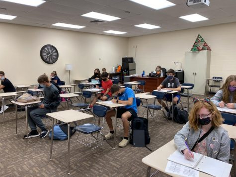 Students work on homework in math teachers Summer Huber's Algebra II class. As of last week, teachers were required to Zoom or have video instructions for their quarantined students.