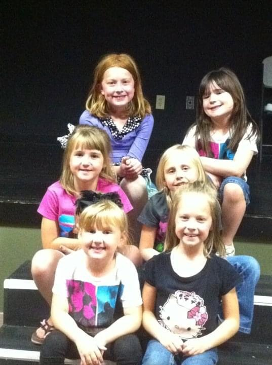 "Junior Kallie Smith (top right) and friends celebrate her seventh birthday with a Justin Bieber themed party. The girls had a lot of candy, watched the ""Justin Bieber: Never Say Never"" movie and played pin the tail on Justin."