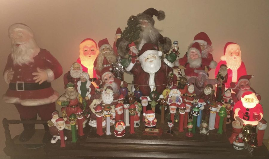 Junior+Tommie+Schaffner+has+a+Santa+collection+in+her+family+room+along+with+Christmas+themed+PEZ+candy+containers.+Schaffner%E2%80%99s+family+puts+all+their+effort+into+the+inside+of+the+house%2C+as+they+do+not+decorate+the+outside.