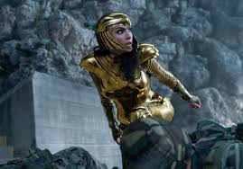 Wonder Woman (Gal Gadot) wears her golden armor, which was created by Pallas Athena and was given to Diana years later.Wonder Woman fights cheetah outside the TV station trying to stop Lord plan for wish granting.