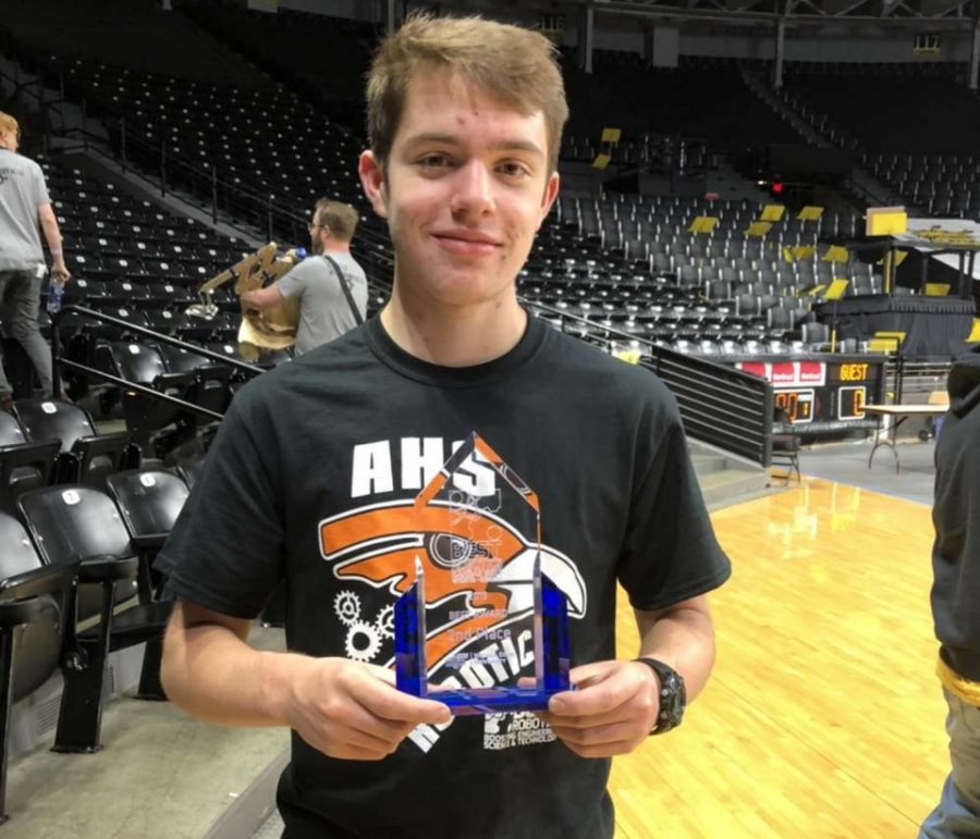 Senior Forrest Tushoff holds his second place award for the B.E.S.T. Robotics regionals. The competition was held at Wichita State University.