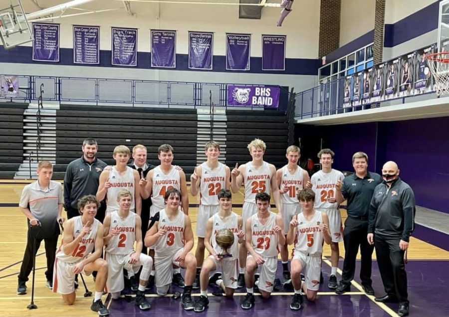 Players, coaches and managers are holding up #1s after claiming the Baldwin Tournament title. Kaden McDaniel, Eli Wilcox and Brendan Parker were all tournament players.