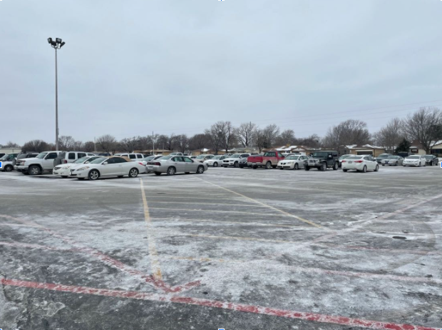 This is only half of the parking lot, and it's pretty full. With some students not being at school due to quarantine and COVID-19, this is not the usual full lot.