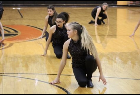 During the 2020 winter dance season, sophomore Lana Wood and junior Trinity Tisdale preform with the dance team in Hutter Gym. Both girls tried out for the 2021-2022 Oriolettes.