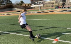 Freshman Peyton Childers shoots the ball before soccer practice while warming up. The varsity girls' first game will be March 22 at home against Mulvane at 6:30 p.m.