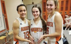 Senior Maycee Anderson, sophomore Aspen Peterson and junior Allie Timberlake pose with a Gatorade after being hype-teammates after winning a game. All of the girls were chosen to be recognized as the hype-teammate.