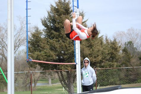 At the home track meet Anderson jumps the pole vault. Warming up to try and break the record that