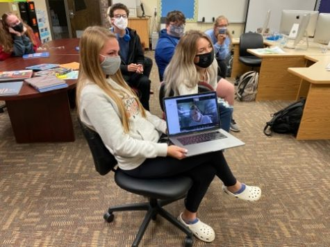 The yearbook staff works together with their Jostens representative to create a cover for the 2020-2021 yearbook. Staff members go over all aspects of the book including picking out the overall theme. The editor also has to pick fonts for everything including layouts, stories, etc.