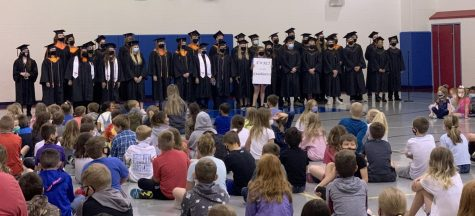 Part of the graduating senior class visits Ewalt elementary where they used to attend. The seniors walked through the building and waved to the students in class.