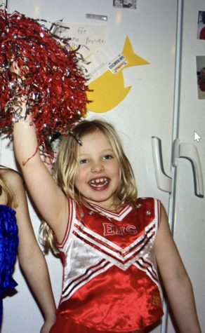 """Six-year-old Alex Svärd shakes a pom pom in her """"High School Musical"""" cheerleading outfit. She enjoyed playing dress up and singing the """"High School Musical"""" soundtrack."""