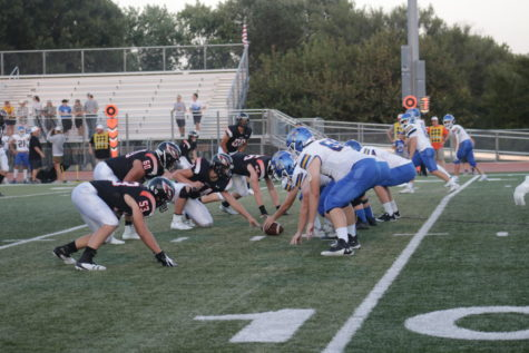 The players are all lined up ready for the quarterback to snap the ball at the home football game between Augusta and Circle. The game ended with Circle winning with a score of 42 - 35.