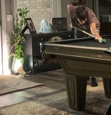 """Junior Ignacio Compte Duch plays pool in his living room. In his free time in America, he likes to play pool. """"I havent been here a lot but when I have free time I like to play pool,"""" Compte Duch said."""